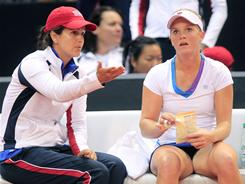 U.S. captain Mary Joe Fernandez, left, talks to Melanie Oudin during the match between Oudin and Andrea Petkovic. Petkovic won to clinch the Fed Cup tie for Germany, which means the USA is relegated for the first time.