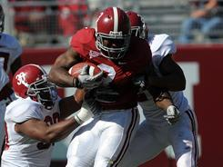Crimson team running back Trent Richardson (3) attempts to break a tackle during Alabama's spring game.