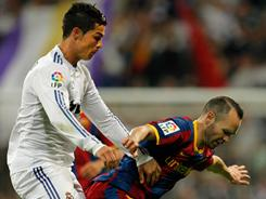 Andres Iniesta, right, won't miss the first leg of Barcelona's Champions League semifinal against rival Real Madrid.