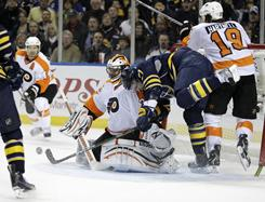 Philadelphia Flyers goalie Brian Boucher saves a shot in traffic during Game 3 of their first-round playoff series in Buffalo.