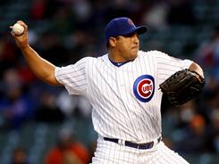 Carlos Zambrano threw eight scoreless innings as the Cubs shut out the Padres, winning on  a Tyler Colvin RBI double in the 10th inning.