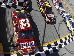 Clint Bowyer, 33, finished just 0.002 seconds behind race-winner Jimmie Johnson, 48, at Talladega Superspeedway on Sunday.