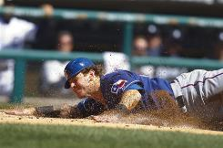 Texas Rangers outfielder Josh Hamilton suffered a shoulder injury sliding into home plate  against the Detroit Tigers at Comerica Park.