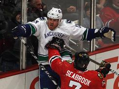 Brent Seabrook reacts to Raffi Torres' hit on him Sunday night. The NHL ruled there would be no suspension for Torres.