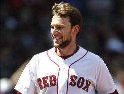 Boston Red Sox infielder Jed Lowrie is all smiles as he approaches the dugout after his two-run home run against the Toronto Blue Jays on Monday in Boston's Fenway Park.