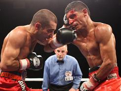 A bloodied Abner Mares, who was cut by an accidental head butt in the first round vs. Vic Darchinyan in December, came back to defeat the Armenian fighter by split decision.