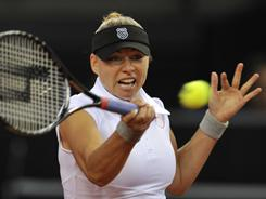 Vera Zvonareva of Russia lines up a forehand during her victory Wednesday against Anastasia Pavlyuchenkova of Russia during their second-round match of the WTA Porsche Tennis Grand Prix tournament in Stuttgart, Germany.