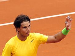Rafael Nadal of Spain acknowledges the cheers after his victory against Gimeno Traver on Wednesday in Barcelona.