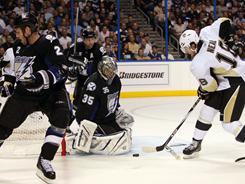 Penguins left wing James Neal (18), shooting on Lightning goalie Dwayne Roloson (35) during the second period, scored the game-winner in double overtime.