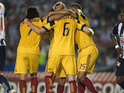 Real Salt Lake players celebrate a goal against Monterrey during their match on Wednesday night.