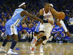 Thunder guard Russell Westbrook, dribbling upcourt as the Nuggets' Ty Lawson (left) defends, tallied 21 points and seven assists to lead Oklahoma City to a 106-89 win.