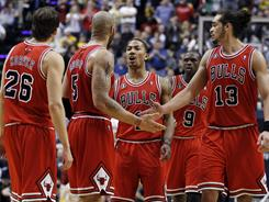 The Bulls' Kyle Korver (26), Carlos Boozer (5), Derrick Rose, Luol Deng (9) and Joakim Noah (13) celebrate a  basket during the second half of their 88-84 win against  the Pacers in Game 3.