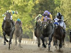 Nehro, far left, almost ran down Archarcharch in the Arkansas Derby on Saturday.
