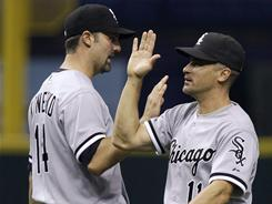 Omar Vizquel, right, and Paul Konerko were two of four White Sox players with two RBI in Thursday night's 9-2 win over the Rays. The win ended Chicago's 7-game losing streak.