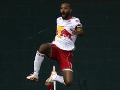 Thierry Henry celebrates after a his first goal against D.C. United. Henry added another later in the first half, and Joel Lindpere and Juan Agudelo made it 4-0 late as the Red Bulls shut out United and Charlie Davies.
