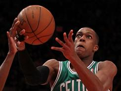 Celtics guard Rajon Rondo drives in for two of his 15 points in Friday's win over the Knicks. Rondo added 20 assists and 11 rebounds to finish with a triple-double.
