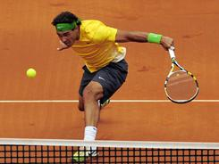 Rafael Nadal hits back at Gael Monfils during their Barcelona quarterfinal. Nadal won 6-2, 6-2.