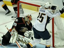 The Predators' Jerred Smithson (25) scored the game-winning goal in overtime past Ducks goalie Ray Emery in Game 5 of their series. Nashville won 4-3 and leads the series 3-2.