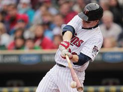 Justin Morneau went 2-for-5 with two RBI in his return from the flu.