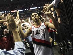 Fans high-five Brandon Roy (7) as he leaves the court following theTrail Blazers' comeback win over the Mavericks in Game 4. Roy scored 18 of his 24 points in the fourth quarter.