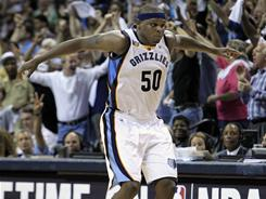 The Grizzlies' Zach Randolph celebrates after hitting a rare three-pointer in the final seconds of their Game 3 victory over the Spurs. Randolph finished with 25 points and five rebounds.