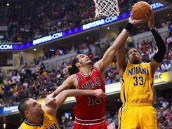 Pacers forward Danny Granger (24 points), right, and Bulls center Joakim Noah (21 points) led their teams in scoring, but Granger and the Pacers were able to avoid elimination in Game 4.