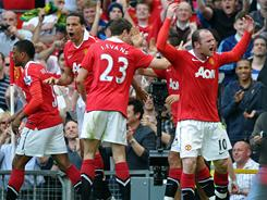 Wayne Rooney, far right, and his Manchester United teammates celebrate Javier Hernandez's goal during their EPL match against Everton. Manchester United won 1-0.