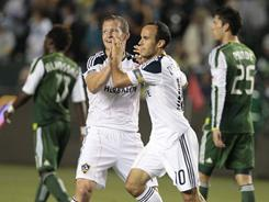 The Galaxy's Landon Donovan, right, celebrates his second goal of the match with Chad Barrett during the second half of their match against the Timbers. L.A. won 3-0.