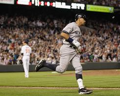 The New York Yankees' Alex Rodriguez rounds the bases after hitting a grand slam off of Orioles pitcher Josh Rupe during the eighth inning of their game in Baltimore.