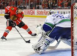 Blackhawks center Michael Frolik dekes before scoring on a third-period penalty shot against Canucks goalie Cory Schneider in Chicago.