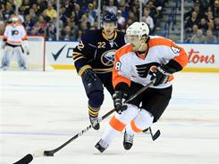 Flyers center Danny Briere (48), taking the puck up ice as Sabres right wing Brad Boyes pursues, scored twice as Philadelphia rallied for a 5-4 overtime win in Buffalo.