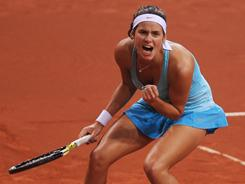 Julia Goerges of Germany pumps her first after capturing the first-set tiebreaker during her victory Sunday against world o. 1 Caroline Wozniacki of Denmark in the final of the Porsche Tennis Grand Prix in Stuttgart, Germany.