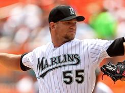Marlins' Josh Johnson's no-hitter was broken up after 5 2/3 innings by Dexter Fowler's double.