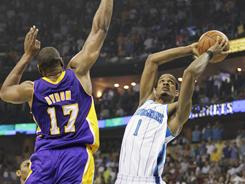 "Trevor Ariza (1) scored 12 points in the first quarter of the Hornets' Game 4 win over the Lakers on Sunday. ""He single-handedly kept us in the game,"" star player Chris Paul said."