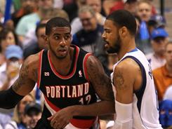 Blazers center LaMarcus Aldridge, left, was kept in check offensively by the Mavericks' Tyson Chandler on Monday night. Chandler, however, gave Dallas a shot in the arm with 14 points and 20 rebounds in the win over Portland.