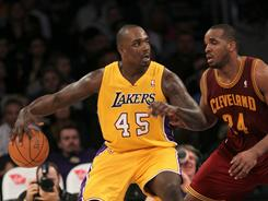 Lakers forward Derrick Caracter, left, dribbling against the Cavaliers' Samardo in a Jan. 11 game, was arrested early Sunday morning in New Orleans.