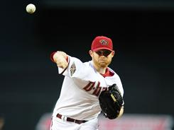 Ian Kennedy threw a complete-game shutout, outdueling Phillies' ace Cliff Lee to earn the Diamondbacks a 4-0 win.