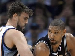 Marc Gasol and the Grizzlies defends the Spurs' Tim Duncan during first-half action, but it was Memphis' defense in the second half that paved the way to a 104-86 victory over San Antonio, who now trails 3-1 in the series.