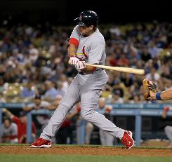 Cardinals outfielder Lance Berkman, shown April 12, is a good bet to hit 30 home runs if he stays in the lineup. To try to keep himhealthy, St. Louis is giving himoccasional days off.