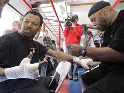 Trainer Naazim Richardson, right, says,