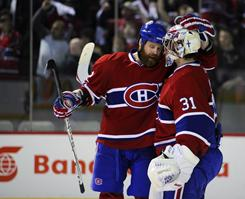 The Canadiens' Paul Mara, left, congratulates goalie Carey Price on their Game 6 victory over the Boston Bruins in Montreal.