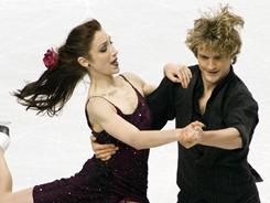 In this Nov. 14, 2010 file photo, Meryl Davis and Charlie White perform their routine in the free dance portion at Skate Americain Portland, Ore. 
