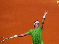 Juan Martin del Potro winds up to serve Tuesday during his victory against Pedro Sousa of Portugal during their first-round match at the Estoril Open.