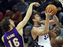 Memphis Grizzlies center Marc Gasol (33) shoots under pressure by his brother, Los Angeles Lakers center Pau Gasol, during an NBA game in November.