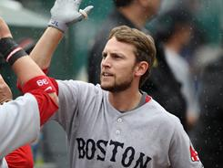 Jed Lowrie, greeted by a teammate, is batting .431 with the Red Sox.