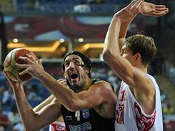 Argentina's Luis Scola, left, attempts to get past Russia's Timofey Mozgov during a playoff at the World Basketball Championship last September in Istanbul.