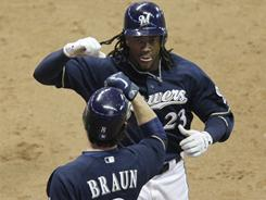 Rickie Weeks (23) gets congratulated by Ryan Braun after Weeks' home run in the eighth inning of the Brewers' 3-2 win over the Reds on Tuesday. Braun also blasted a homer in the win.