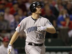 Adam Lind (26) had three hits, including two home runs, in the Blue Jays' 10-3 win over the Rangers on Tuesday night. The home loss is just Texas' fourth in 14 games.