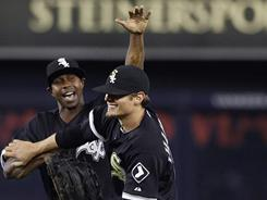 Left fielder Juan Pierre, left, congratulates right fielder Brent Lillibridge after Lillibridge made two great ninth-inning catches to preserve the White Sox's 3-2 win over the Yankees.