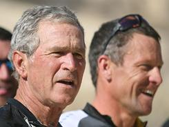 Former President George W. Bush, left, stands next to seven-time Tour de France winner Lance Armstrong on April 27 at Big Bend Park, Texas.
